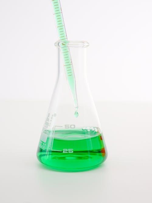 Purple Liquid in Clear Glass Bottle
