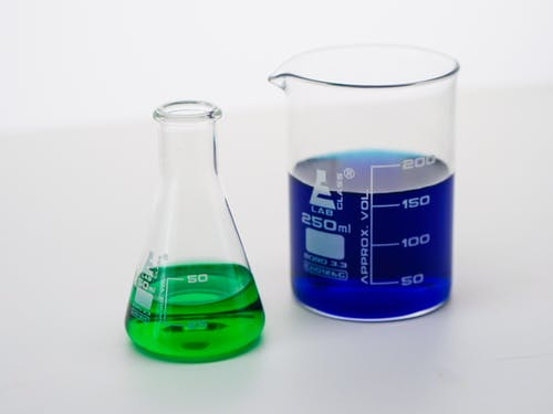 Close-Up View of Colorful Liquids in Laboratory Glasswares