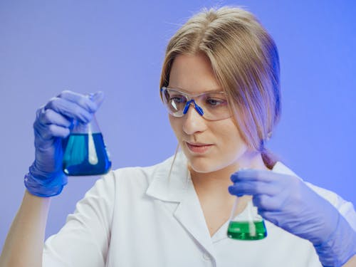 Close-Up Photo of a Woman Doing an Experiment