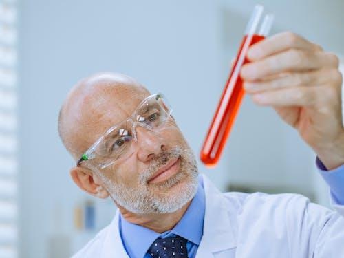 Close-Up Photo of a Man Doing an Experiment