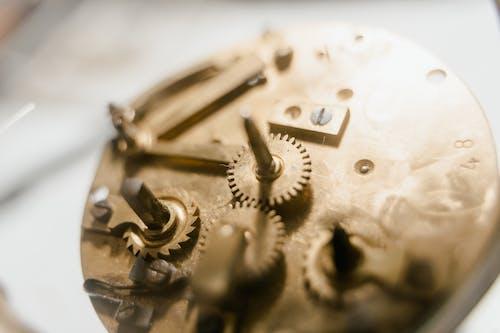 Close-Up Shot of a Gold Gear