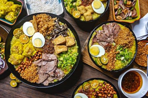 Cooked Food on Black Ceramic Plate