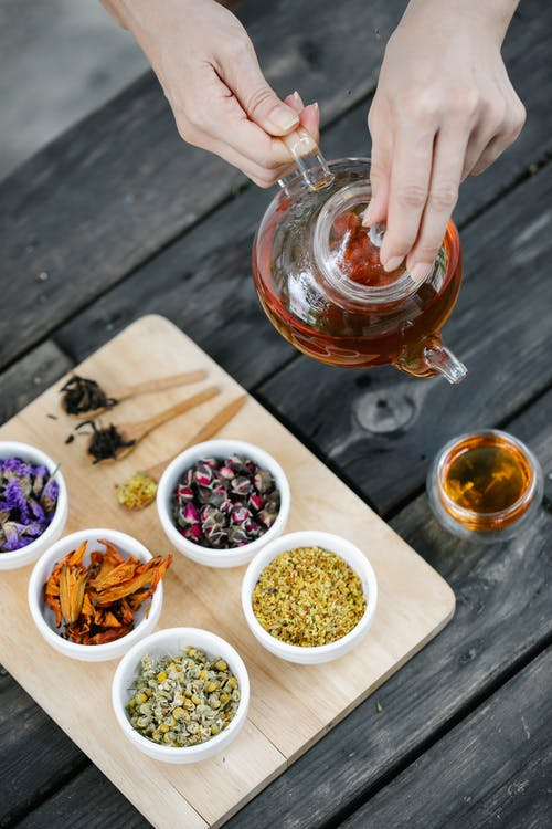 Assorted Herbs on Wooden Chopping Board