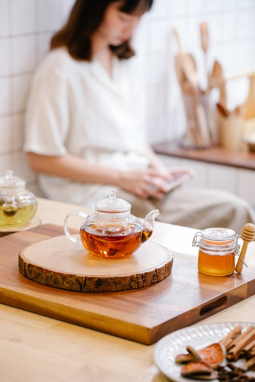 Clear Glass Teapot on Brown Wooden Tray