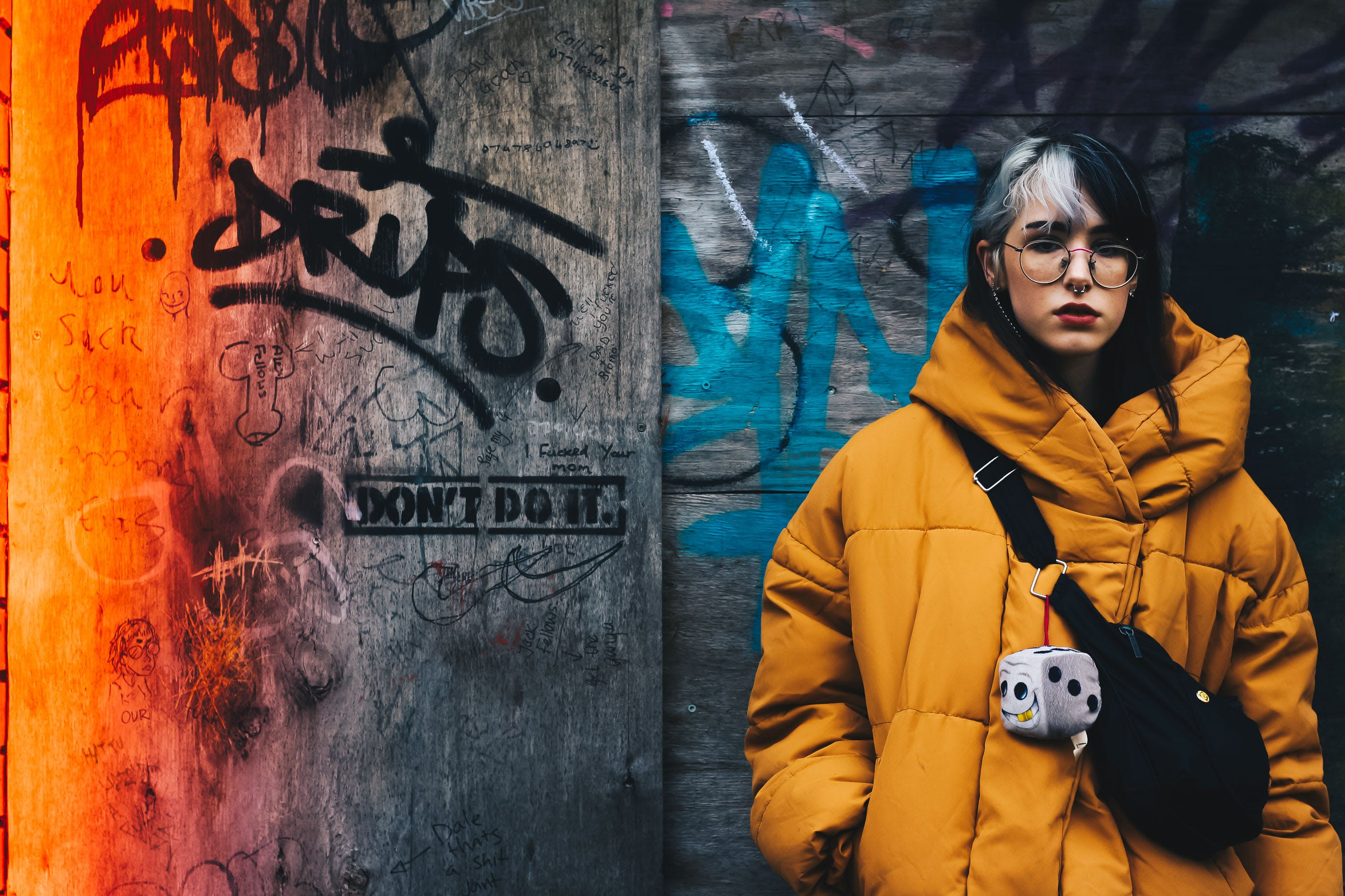 Woman in Yellow Coat With Black Crossbody Bag Closing Her Eyes