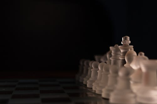 Close Up Shot of Clear Chess Pieces