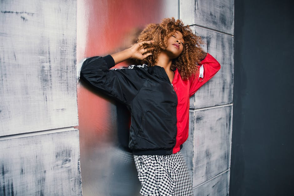 Woman in Red and Black Bomber Jacket