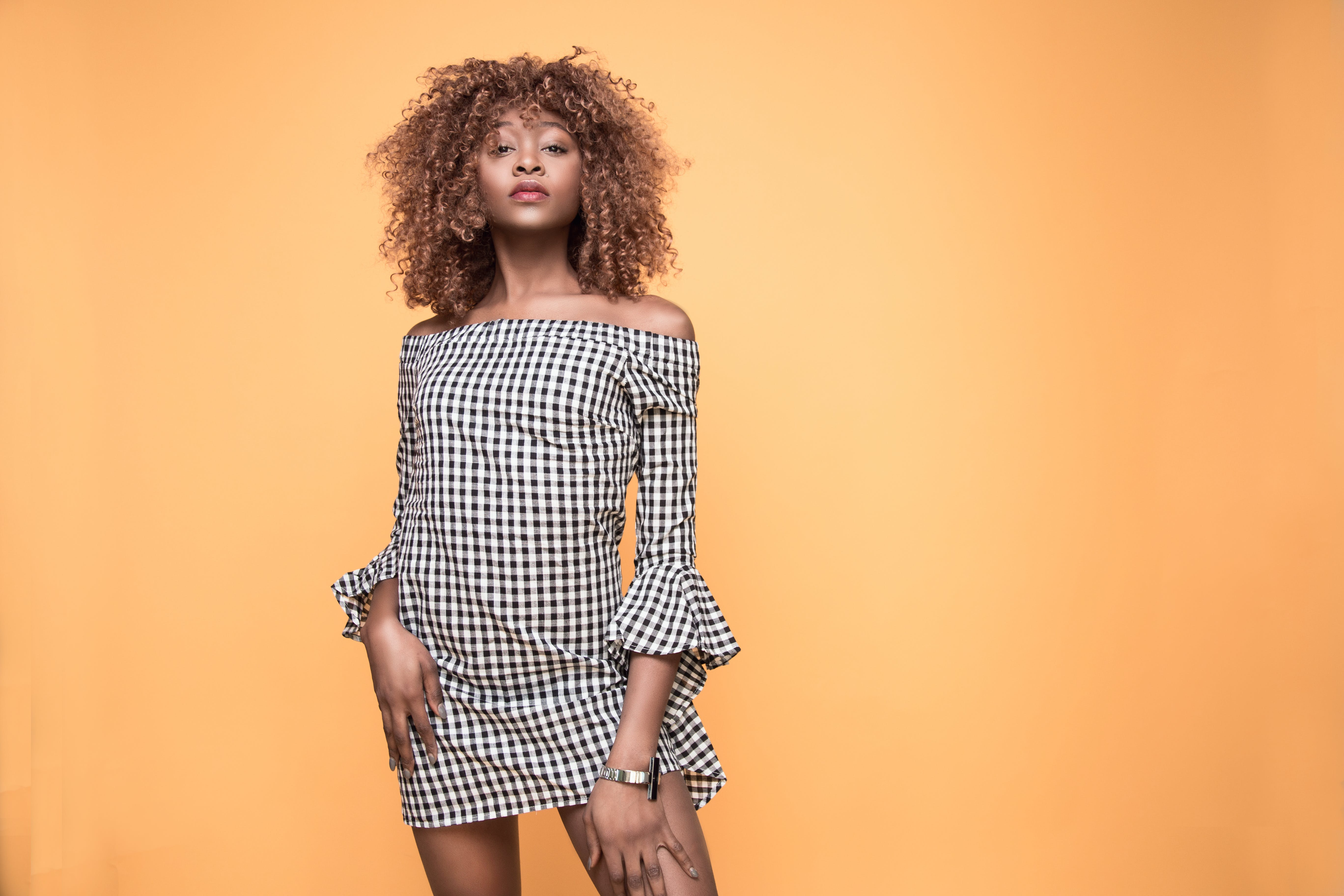 Woman Wearing Checked Bell-sleeved Dress With Orange Background