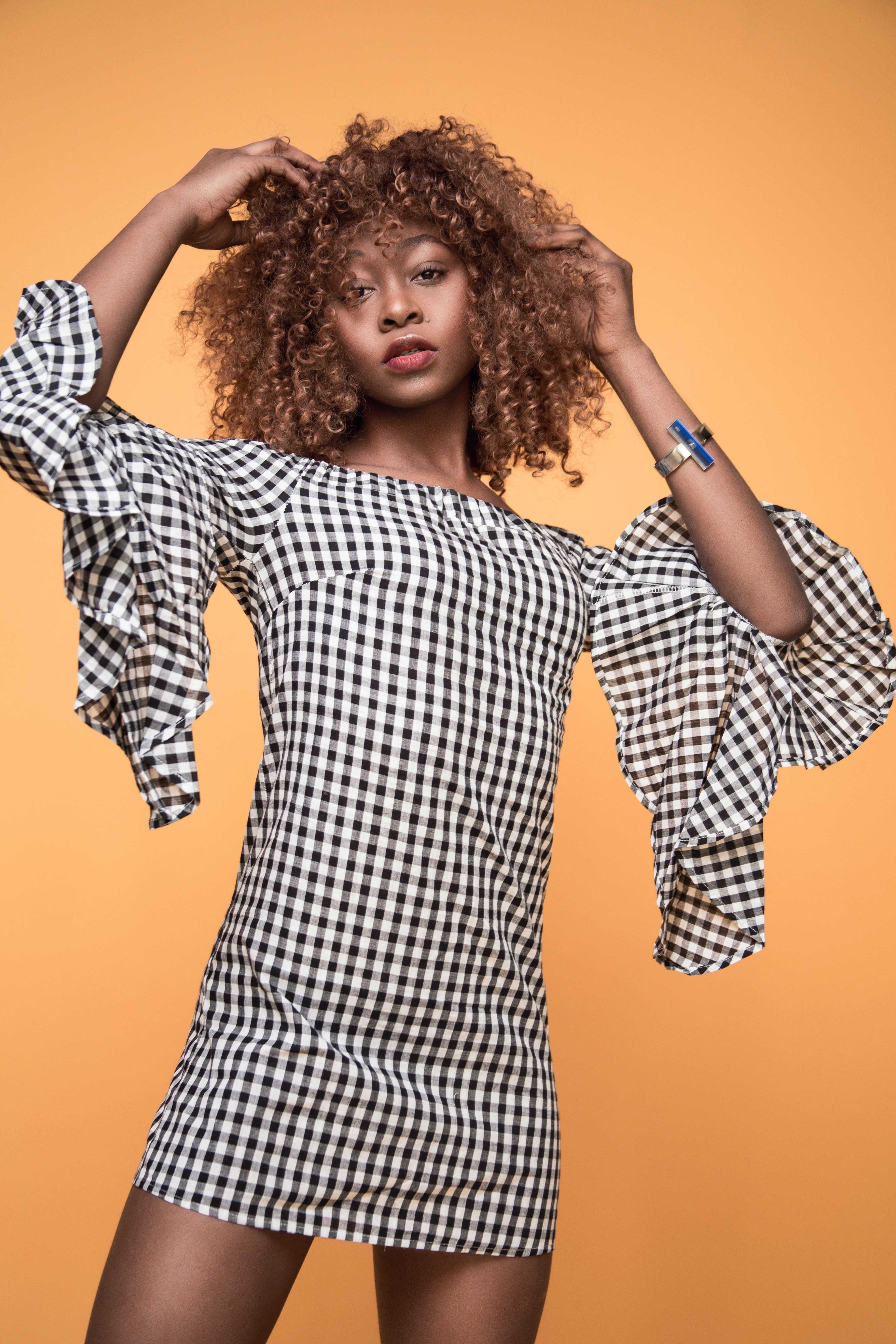 Woman Wearing White and Black Checkered 3/4 Sleeved Shirt