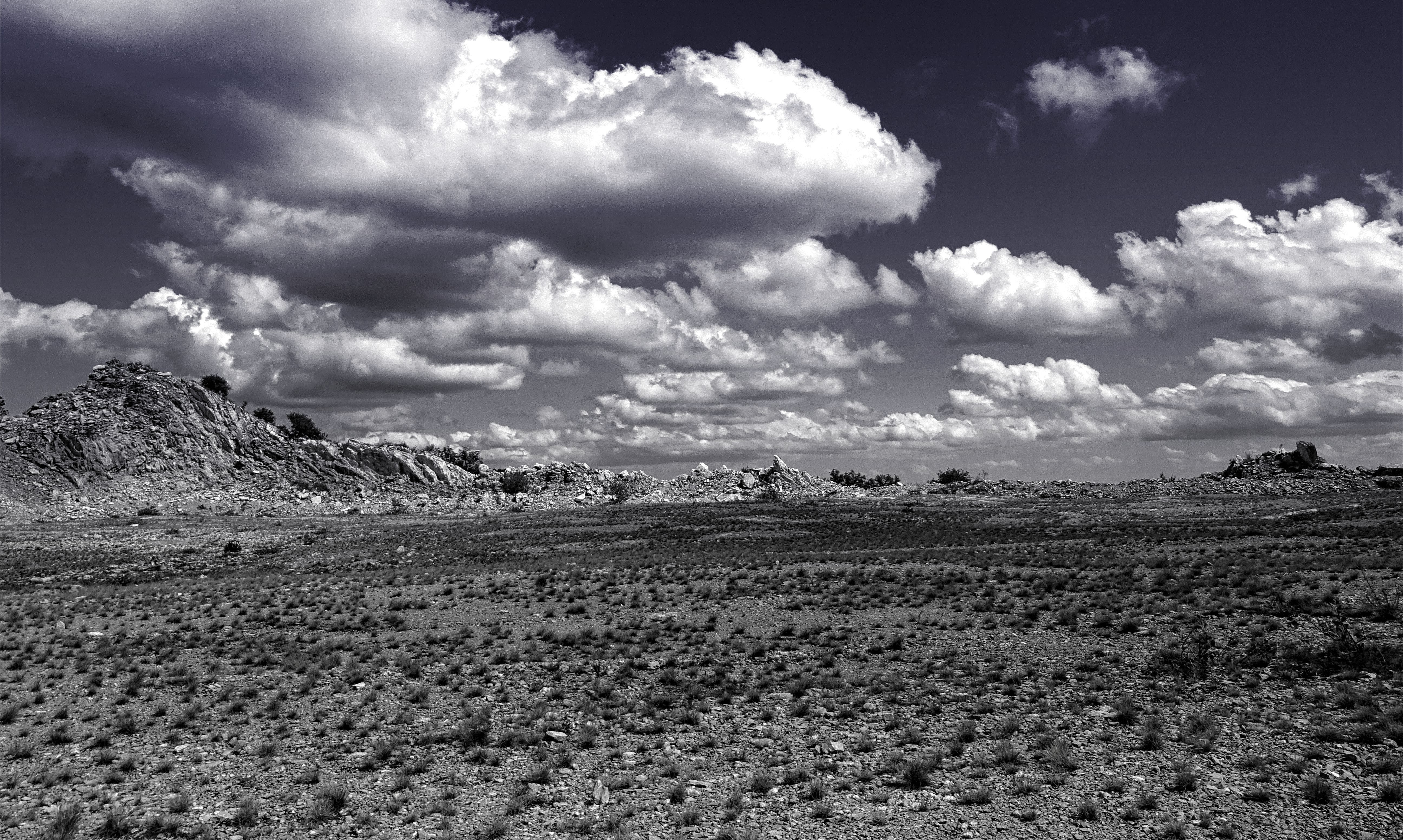 Gray Sands With Gray Skies and White Clouds Photography