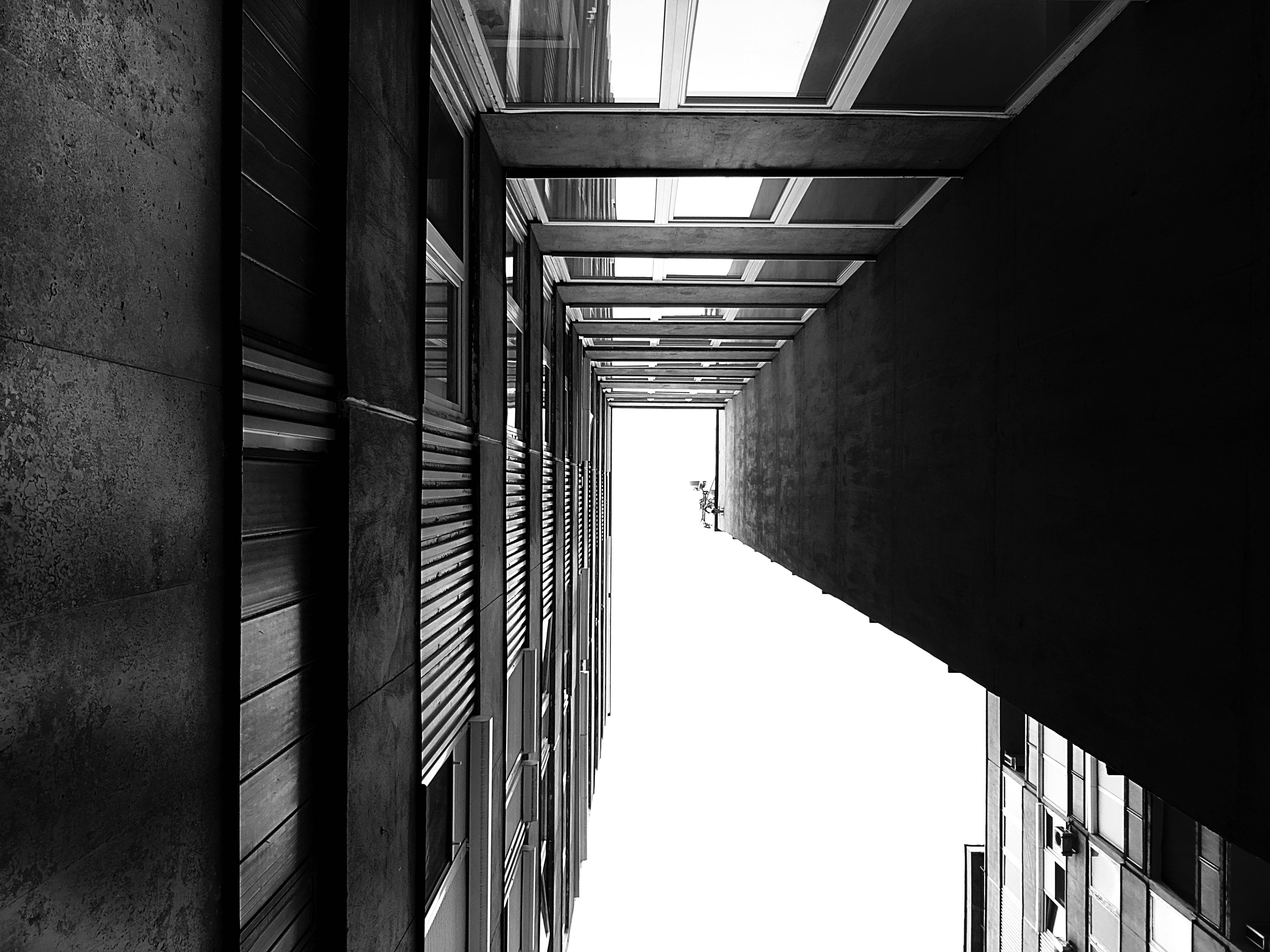 Graysacle Photography of Low Angle High Rise Building