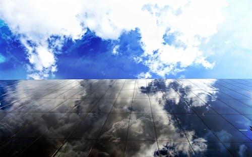 Fotobanka sbezplatnými fotkami na tému budova, deň, denné svetlo, mraky