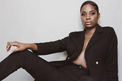 Woman in Black Blazer and Brown Dress Pants