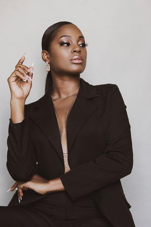 Woman in Black Blazer Standing