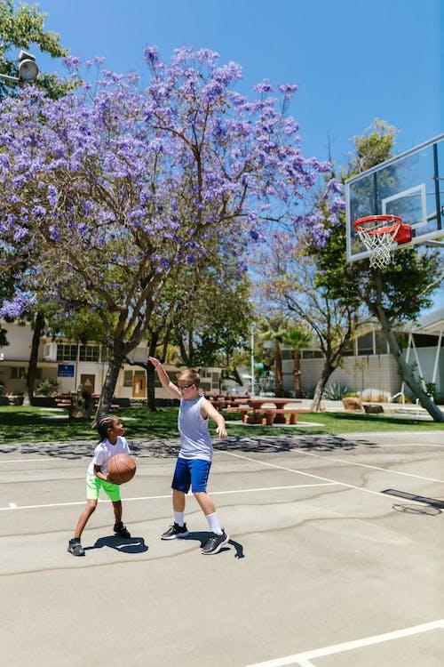 2 Men Playing Basketball
