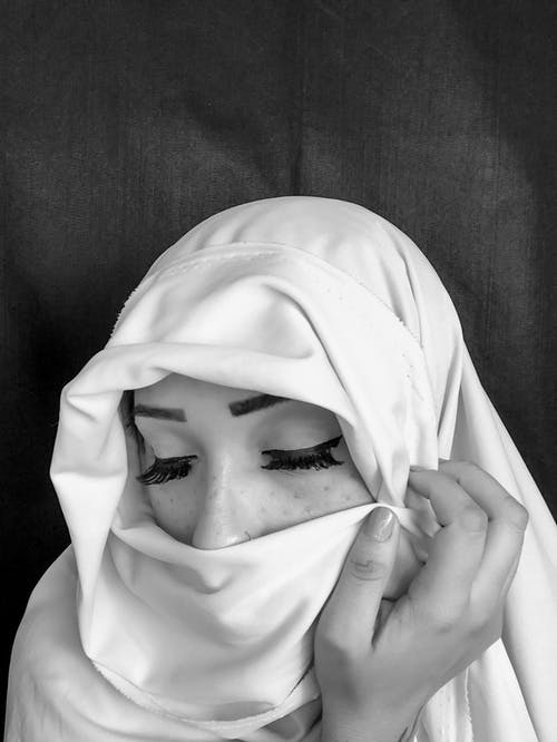 Person Wearing White Hijab Covering Face