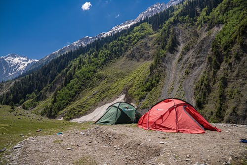 Red and Green Tents near Mountains