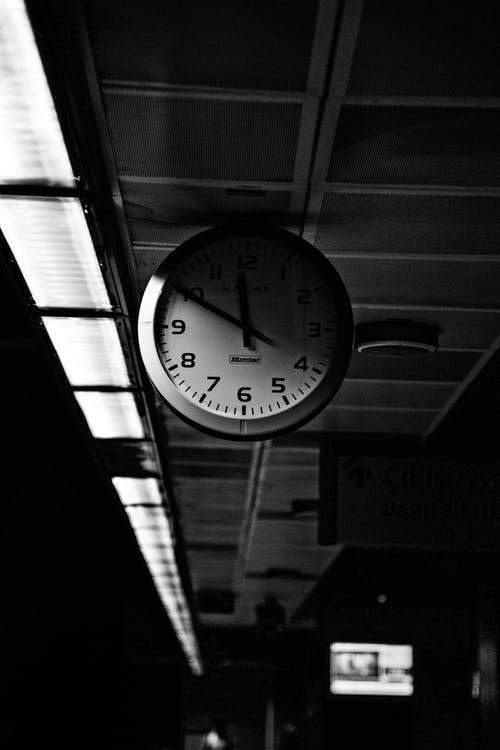 Grayscale Photo of Round Analog Wall Clock