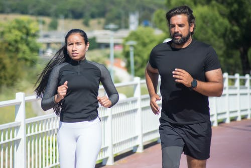Man and Woman Jogging Outdoors