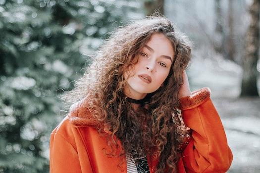 Woman in Orange Zip-up Jacket