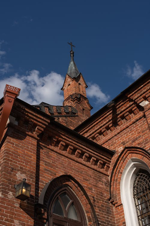 Red Brick Church Under Blue Sky