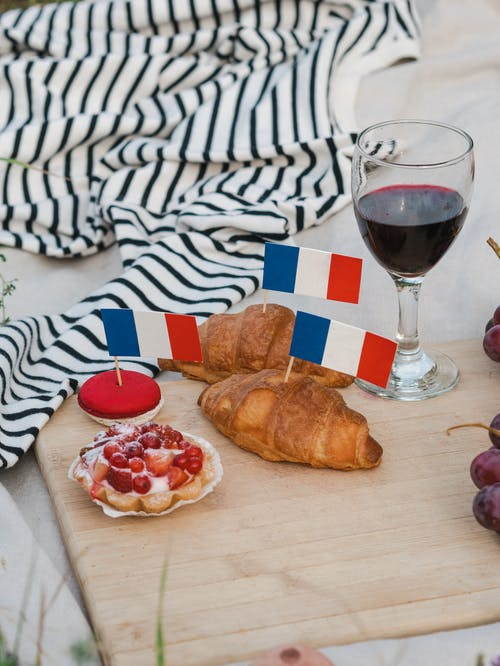 Bread With Red Wine on Brown Wooden Table