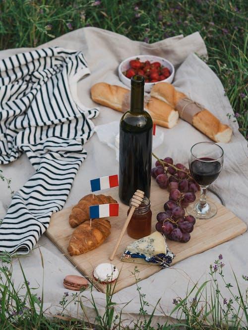 Wine Bottle on Brown Wooden Chopping Board