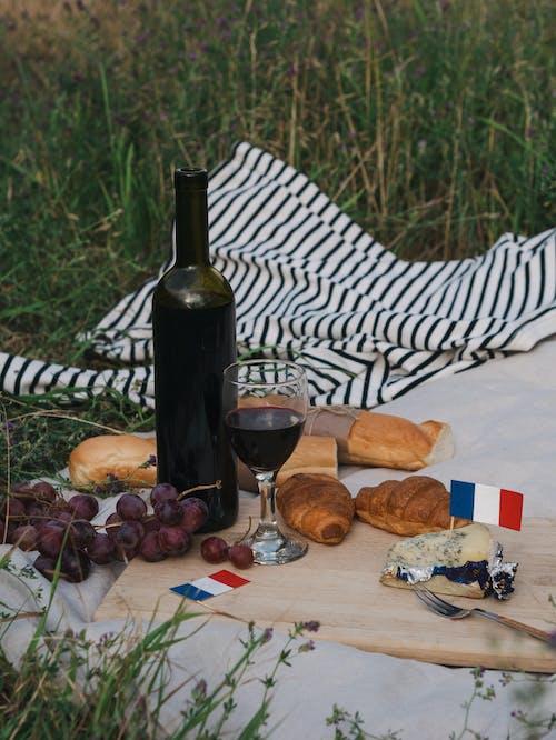 Wine Bottle Beside Bread on Table