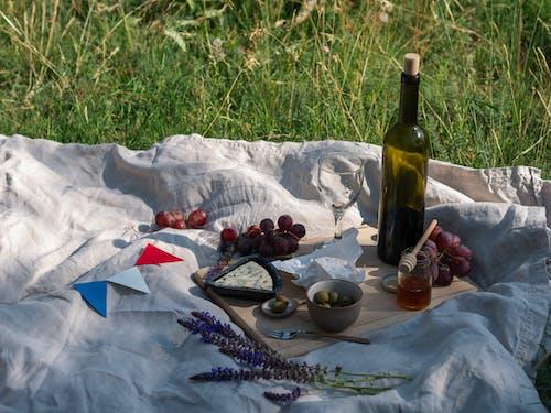 Wine Bottle on White Textile