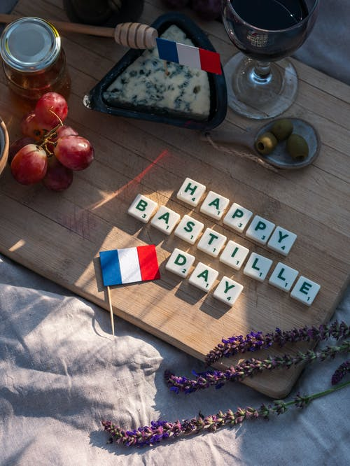 White and Blue Wooden Blocks on Brown Wooden Table