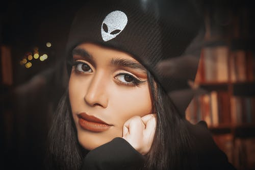 Close-Up Shot of a Beautiful Woman in Black Beanie Looking at  Camera
