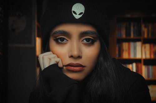 Woman in Black Under Armour Knit Cap