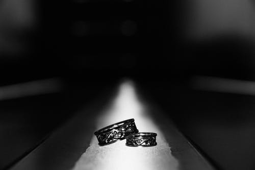 Monochrome Photo of Two Engagement Rings