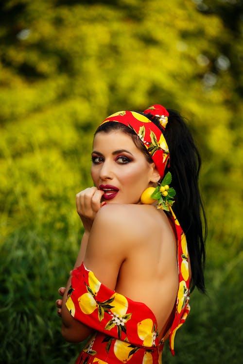 Girl in Red and Yellow Floral Bikini Top