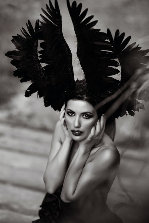 Grayscale Photo of Woman With Black Wings