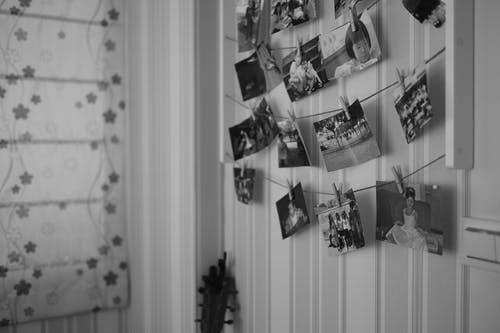 Grayscale Photo of Hanging Clothes