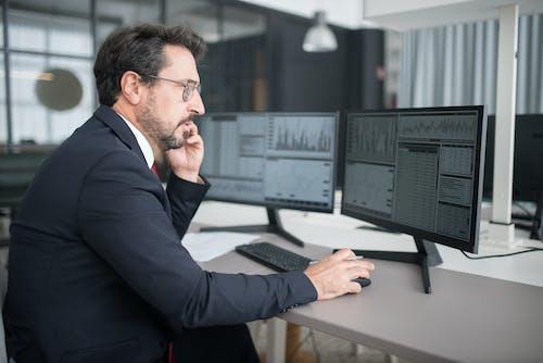 Man in Black Suit Jacket Using Computer