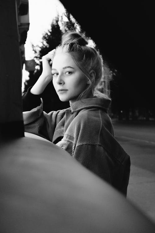 Grayscale Photo of Girl in Hoodie