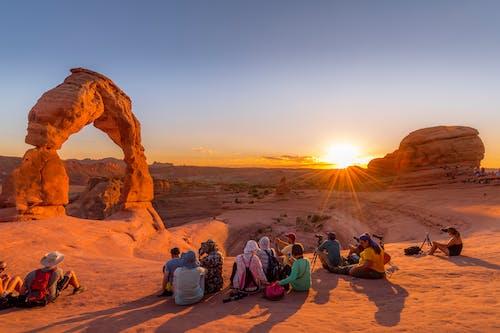 People Sitting on Brown Sand