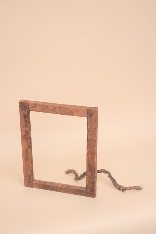 Brown Wooden Frame on White Table