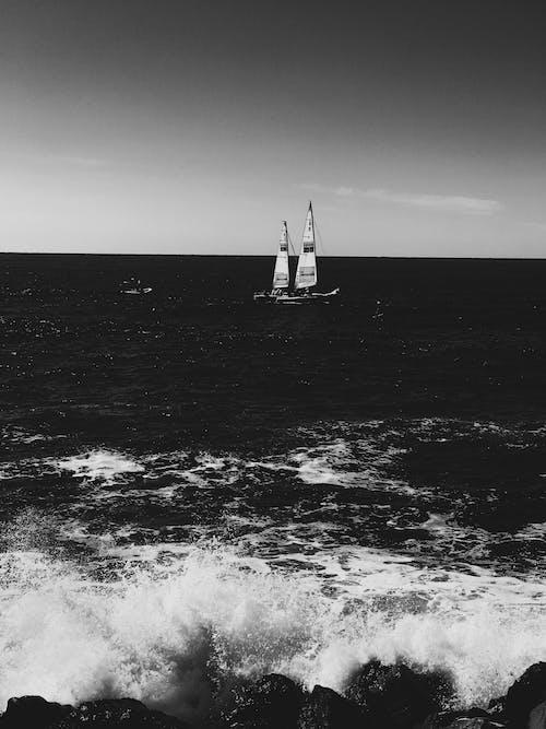 Grayscale Photo of Sailboat on Sea