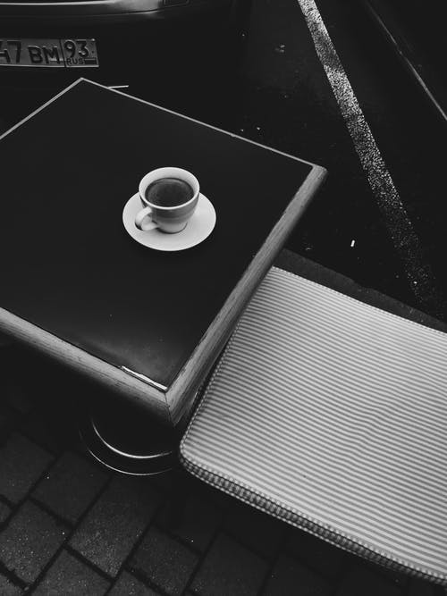 White Ceramic Cup on Black Table