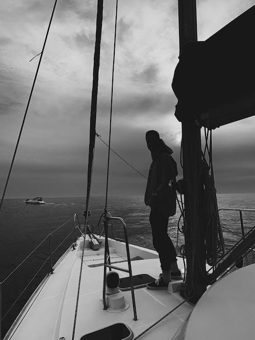 Man in Black Jacket Standing on Boat
