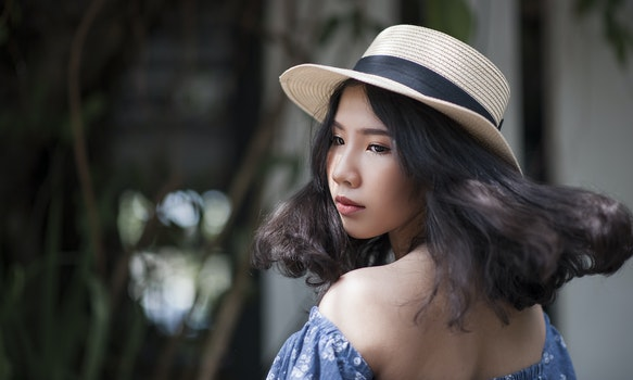 Woman Wearing Fedora Hat and Off-shoulder Top