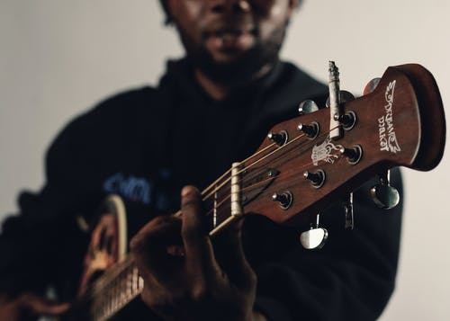 Man in Black Crew Neck T-shirt Holding Brown Acoustic Guitar