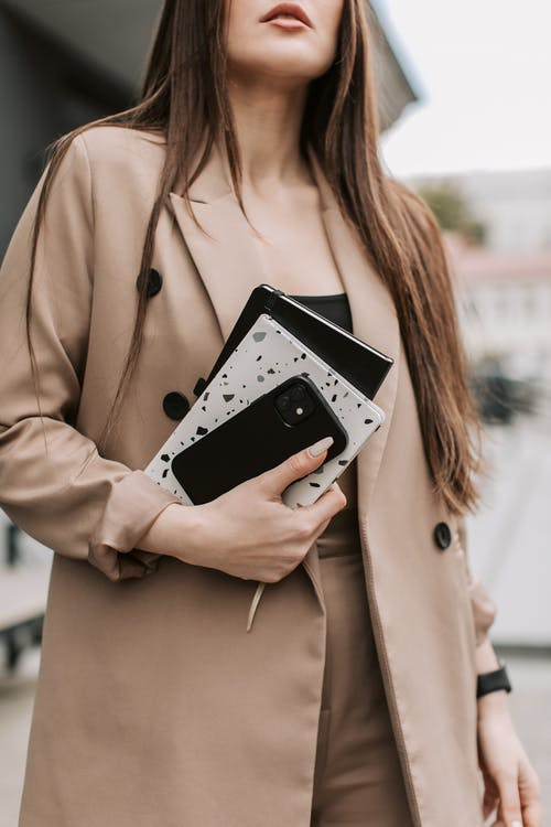 Free stock photo of brown jacket, computer laptop, female