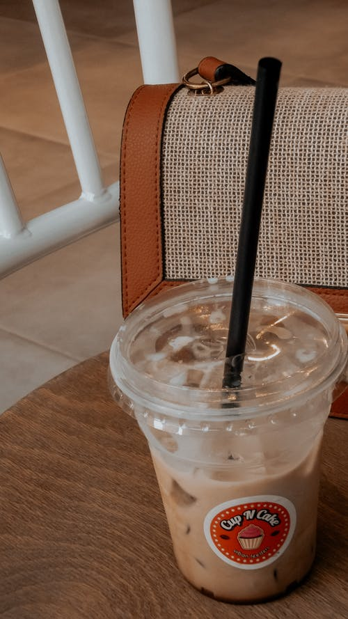 Cold Drink in a Clear Plastic Cup With Black Straw