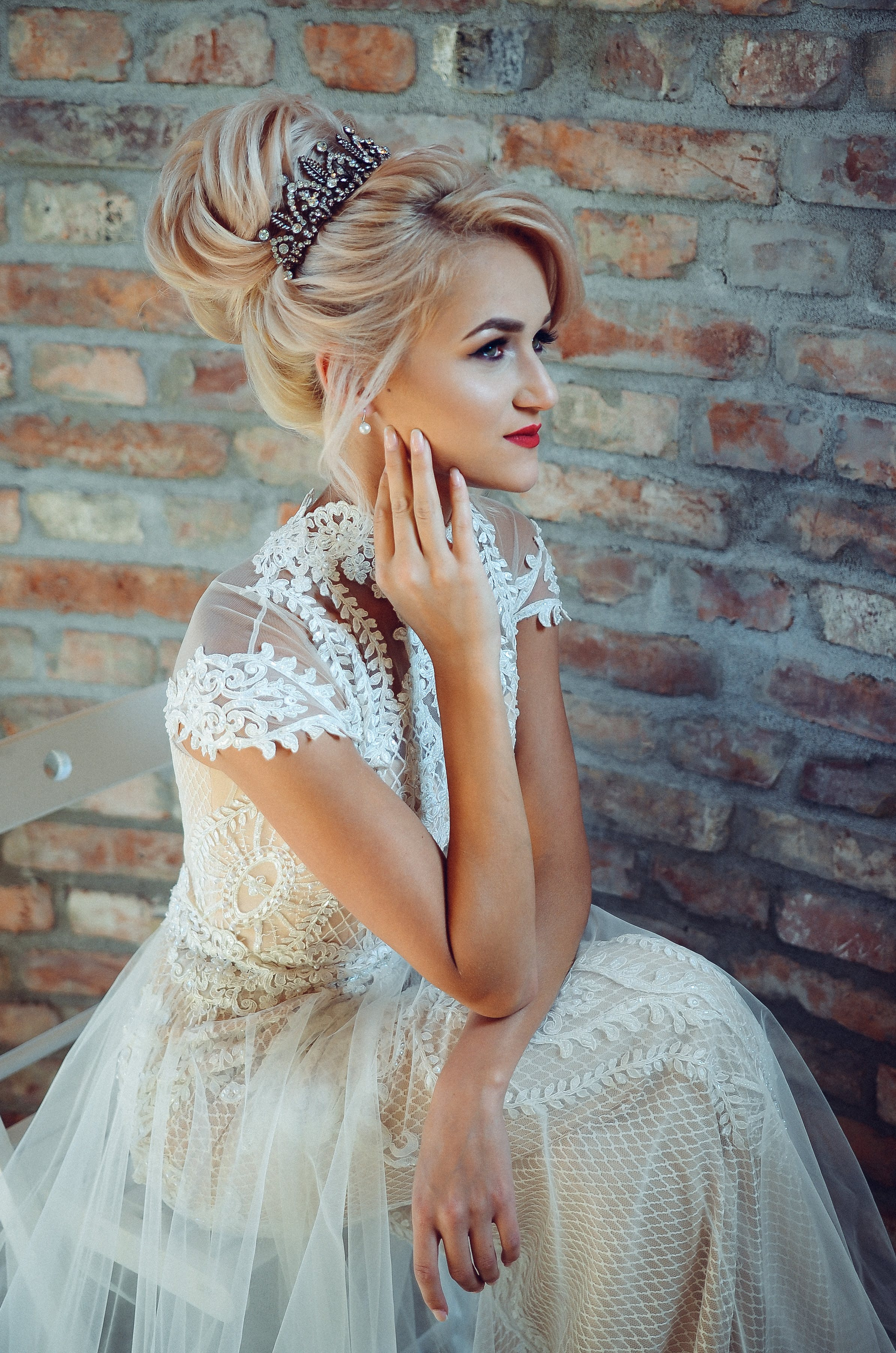 Woman in White Lace Dress Sits on Chair