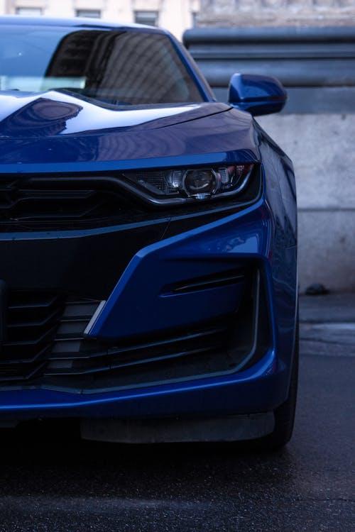 Blue Car with a Projector Headlight