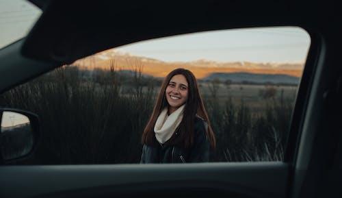 Woman in Black Jacket Sitting on Car